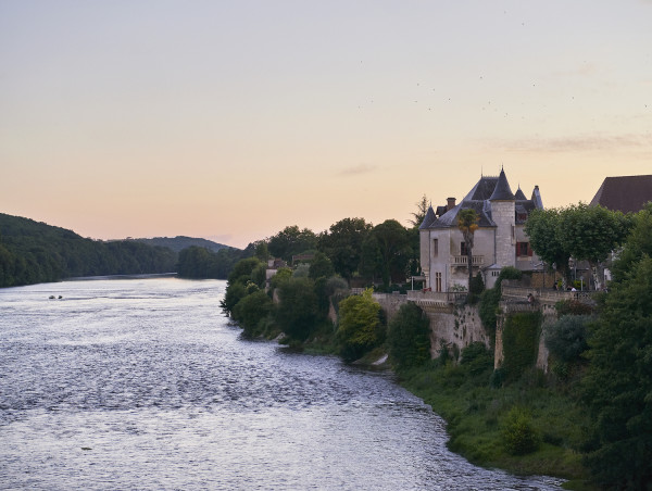 View of the Dordogne river at Lalinde with Château Lalinde on the right